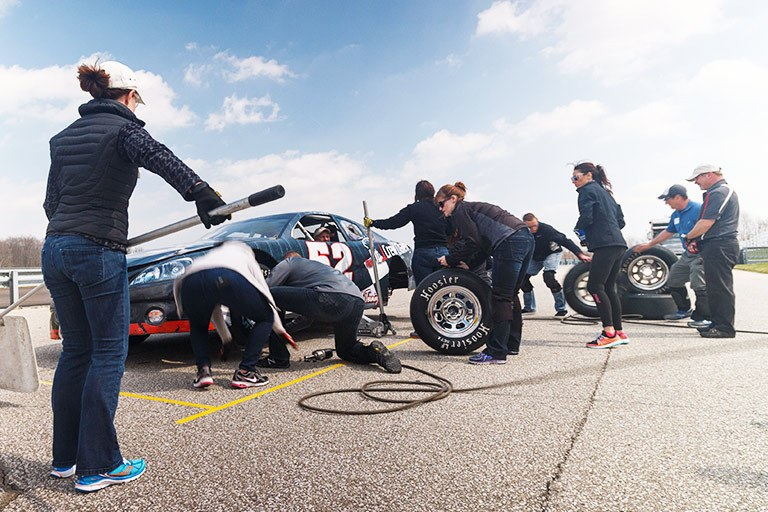 A pit crew works on a race car at the Indianapolis 500.