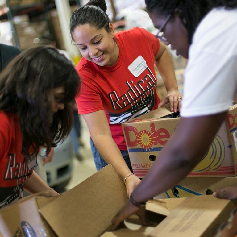 Students sort through boxes as part of a community service project.