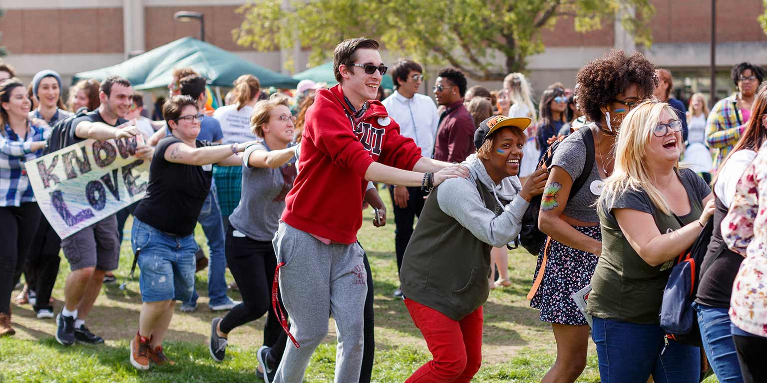 Students form a conga line at a festival on the IUPUI campus.