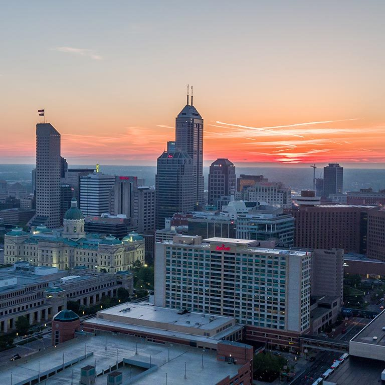 An aerial view of the Indianapolis skyline at sunset
