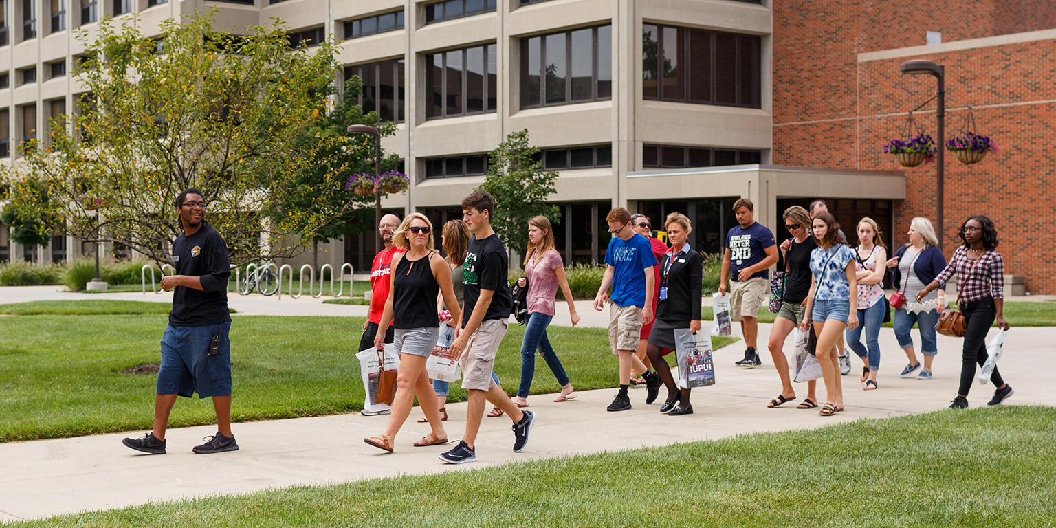 Prospective students and their families walk through one of IUPUI's skywalks during a campus tour.